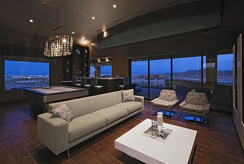 Luxury modern bar game room with wood floors and city views