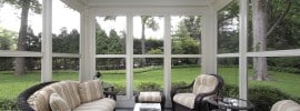 sun-room-with-many-windows-and-garden-view