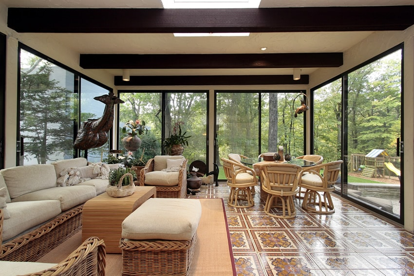 Sun room with view of forest