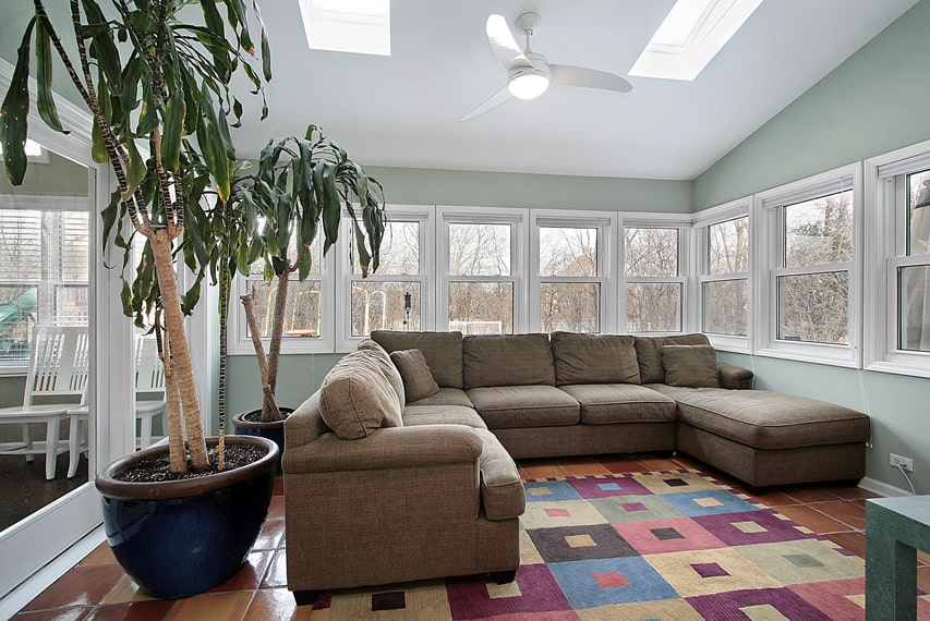 Sunroom with large sectional couch