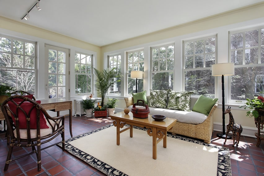 Sunroom with view of trees