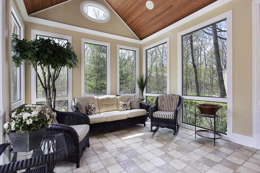 Upscale sunroom with comfy furniture