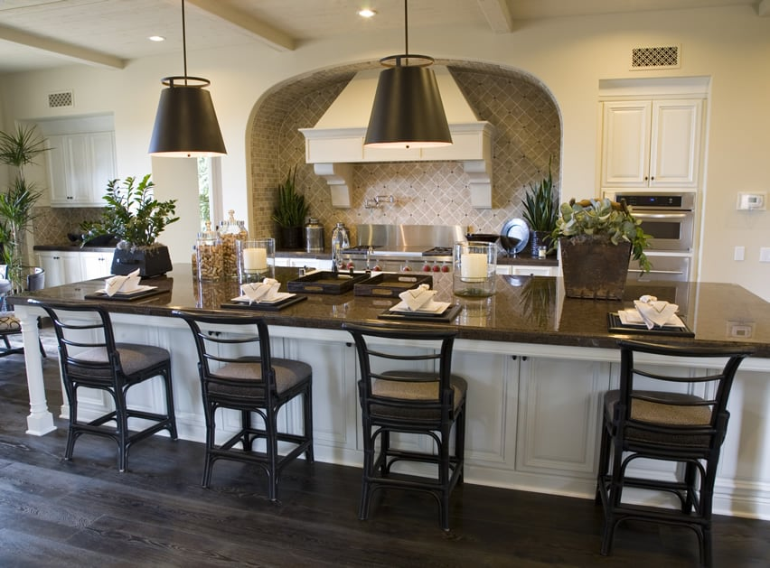 Large dine in kitchen island with black granite countertop