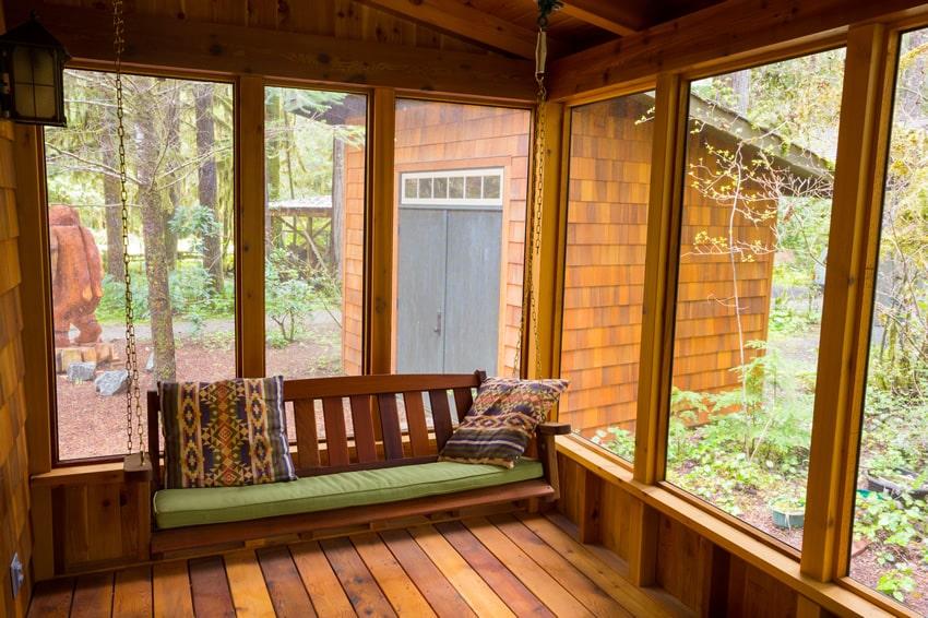 Wood sunroom with bench swing