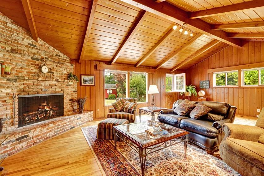 Wood sunroom with brick fireplace