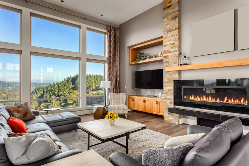 Amazing view living room with gray furniture and electric fireplace