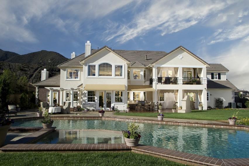Backyard pool and spa with brick trim