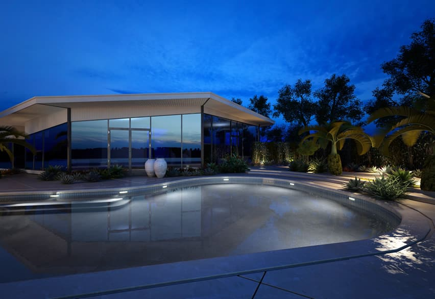 Backyard pool at modern home at night