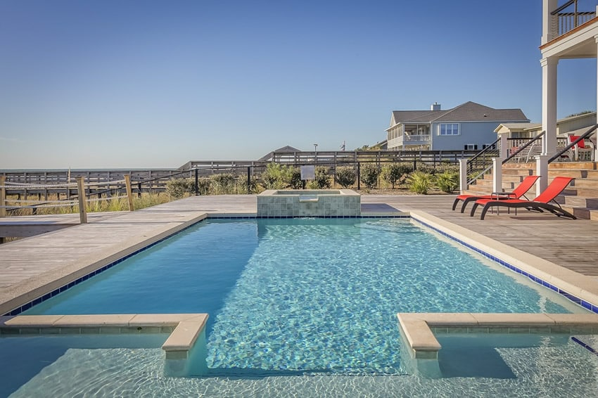 Beautiful blue pool with elevated hot tub
