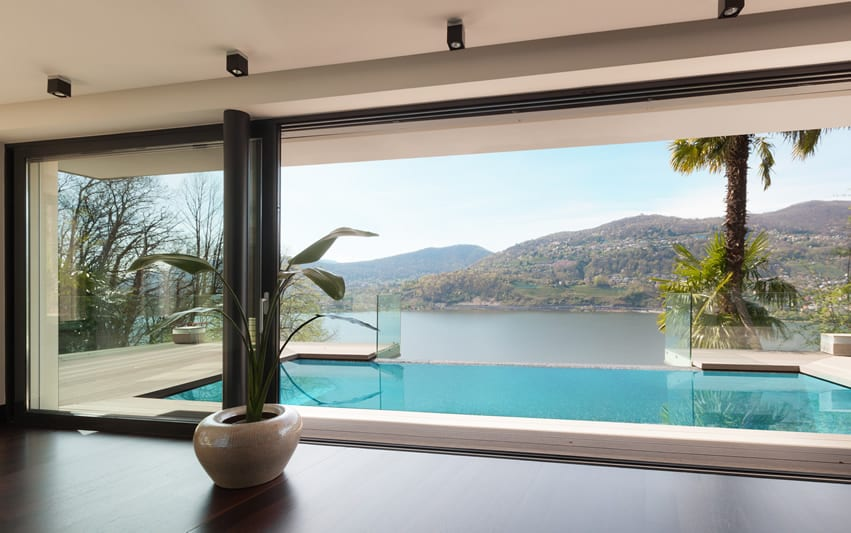 Beautiful infinity pool at home with lake view