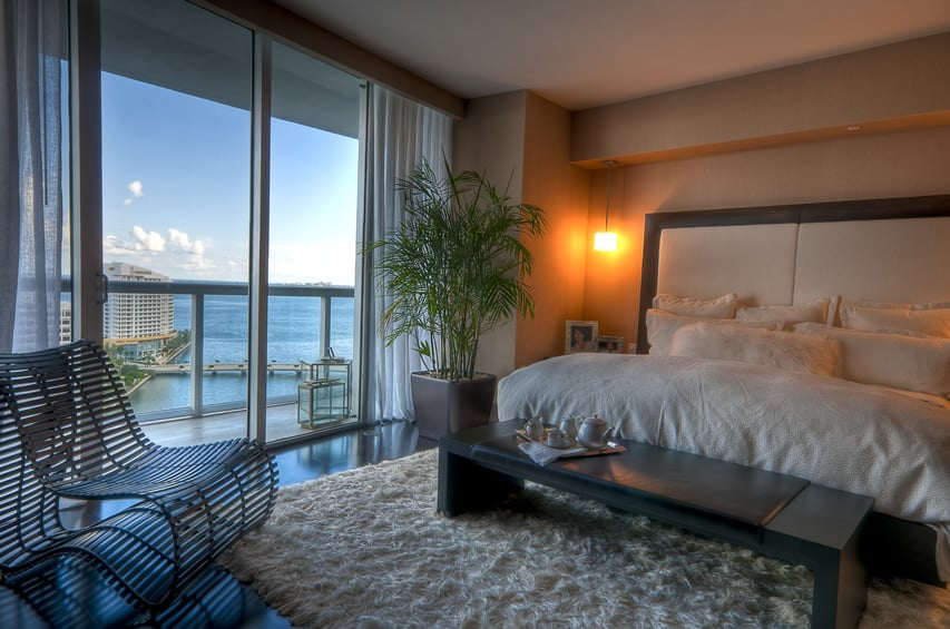 Beautiful penthouse retreat bedroom with water views