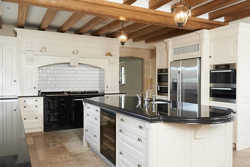 Beautiful u shaped kitchen with exposed beams