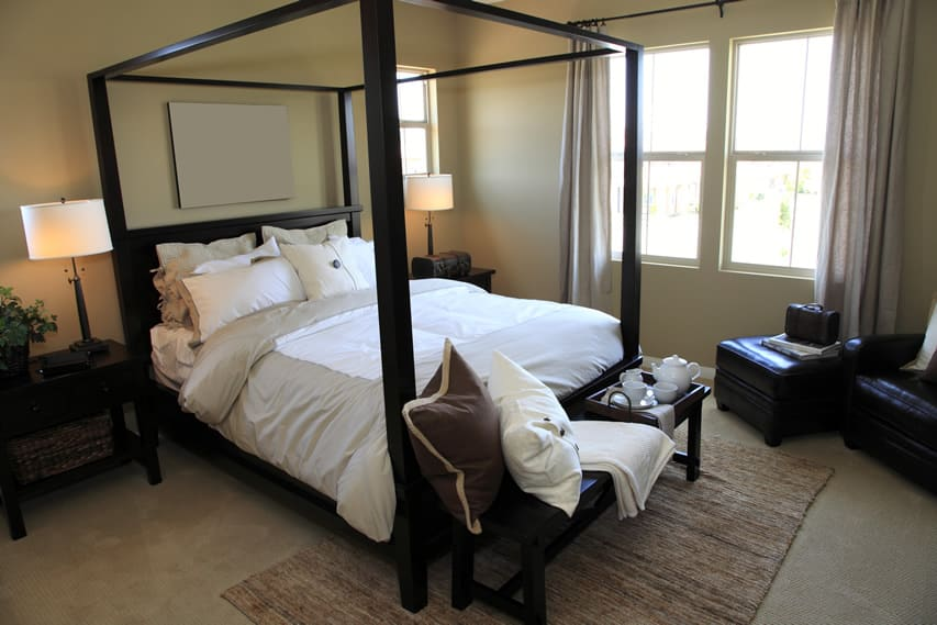 Bedroom four poster bed and leather furniture