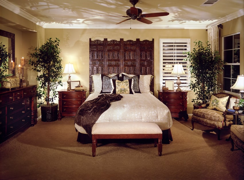 Bedroom with brown carpet white bedding