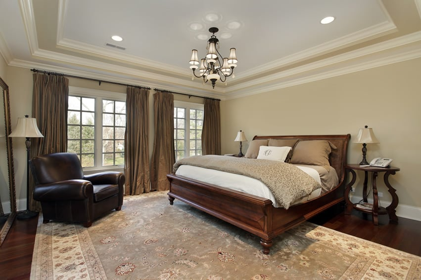 Bedroom with large rug and sleigh bed
