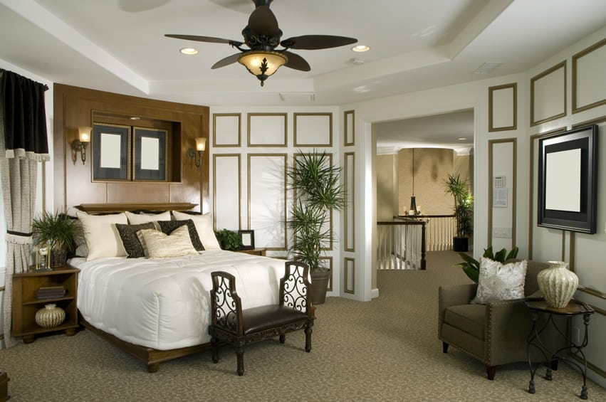 Luxury bedroom with white and gold trim walls