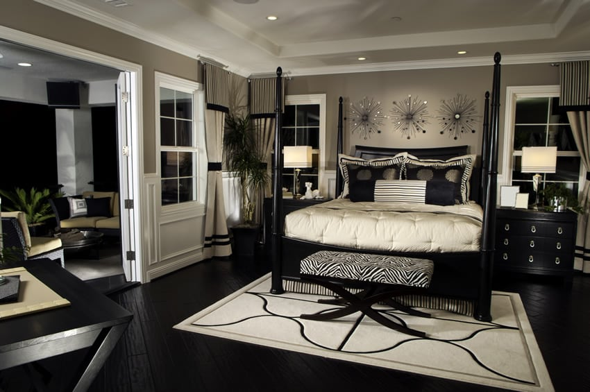 Black and white theme bedroom with sitting area