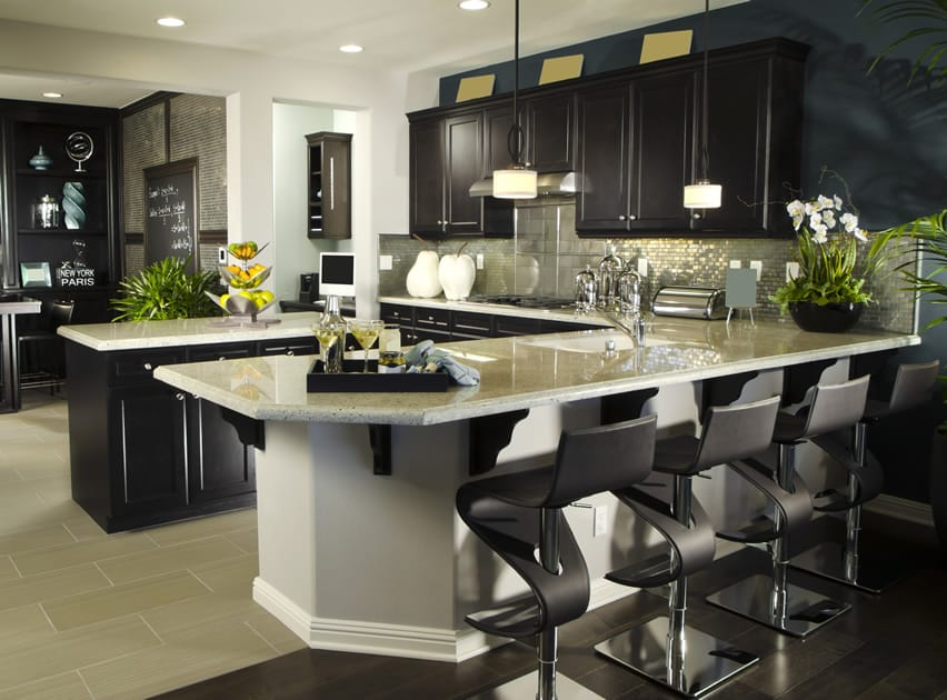 Contemporary L shaped kitchen with modern barstools