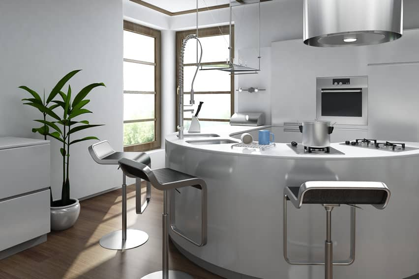 Curved modern kitchen in white with stainless bar stools