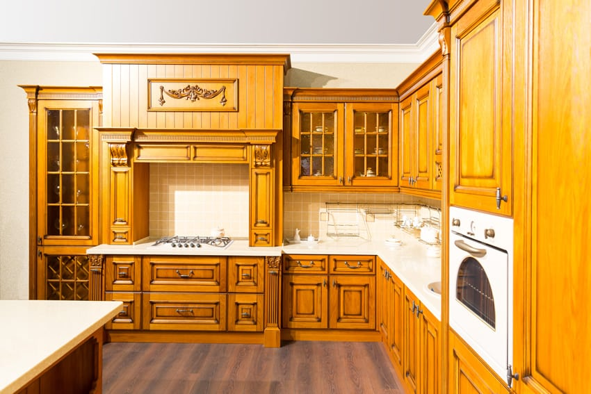 Custom l shaped wood kitchen with decorative design