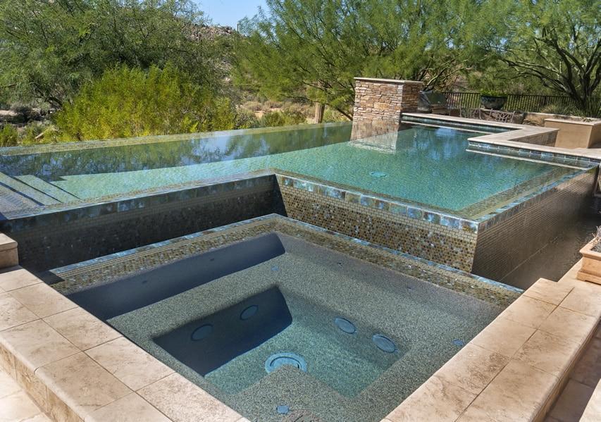 Custom pebble pool and spa with tile trim