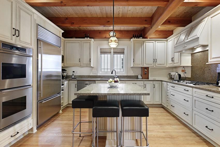 Custom white u shaped kitchen design