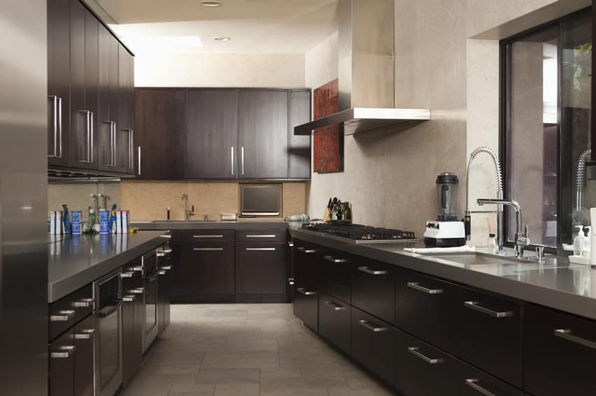Dark modern galley kitchen with chrome metal hardware