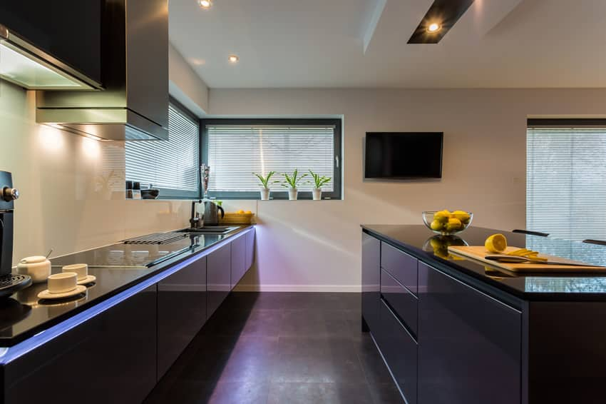 Dark modern kitchen with under counter lighting