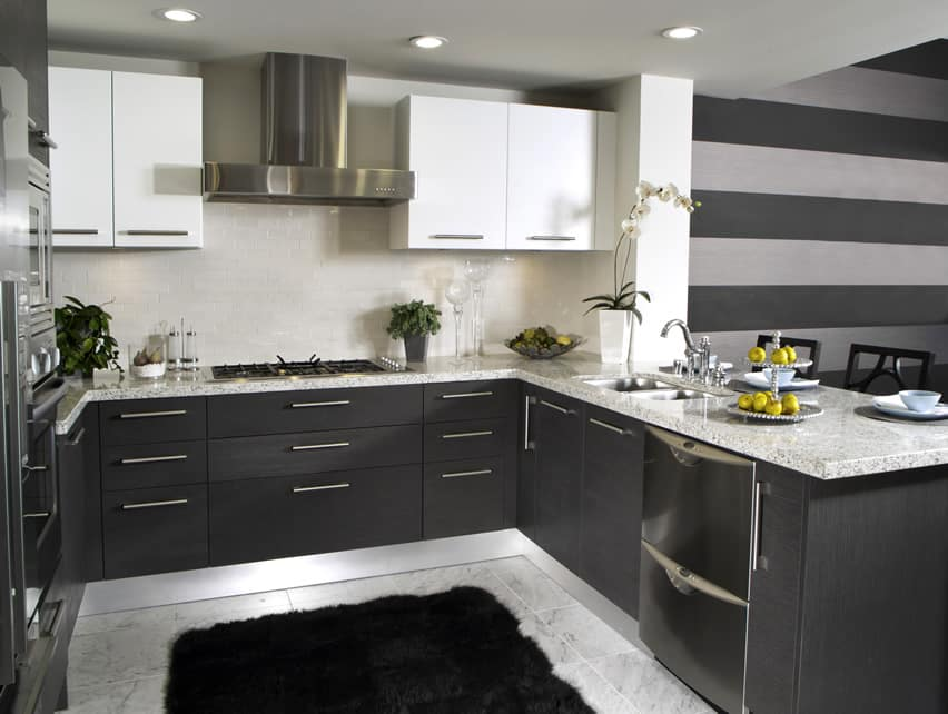 Dark u-shaped kitchen with subway tile backsplash