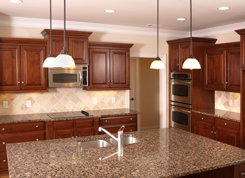 Dark wood l shaped kitchen