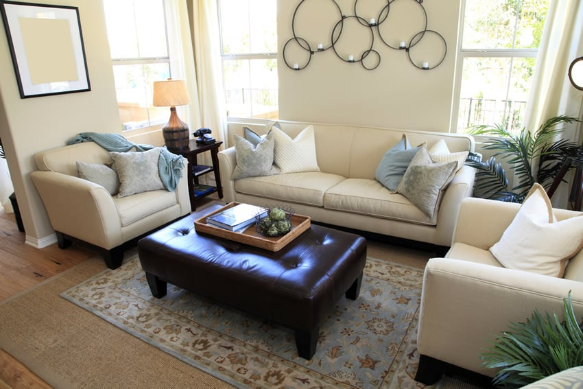 Designer decorated living room with leather ottoman