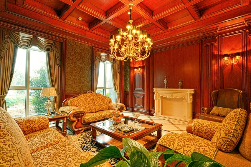 Elegant living room with custom wood ceiling and victorian furniture