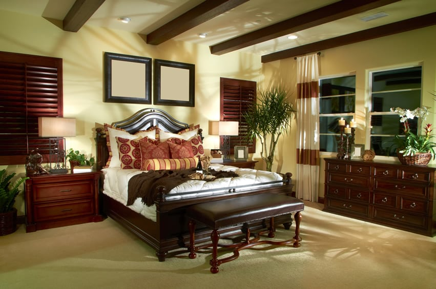 Elegantly decorated bedroom with wood shutters and furniture