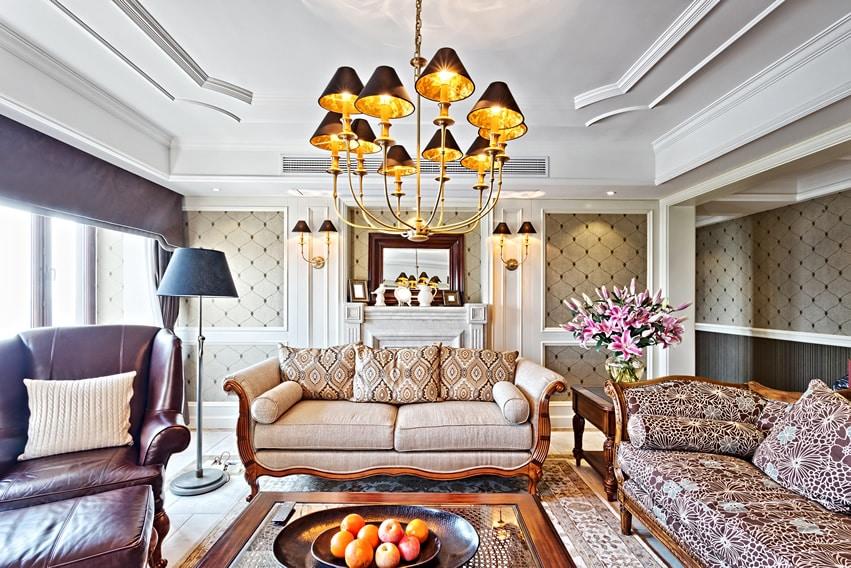 Elegantly furnished living room with decorative ceiling