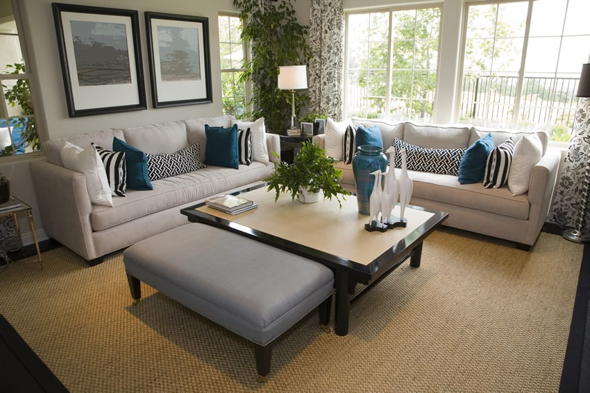 Formal living room with large coffee table and ottoman