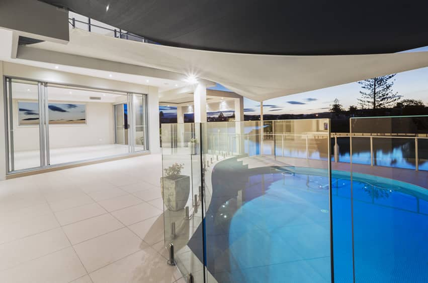 Glass enclosed swimming pool overlooking river
