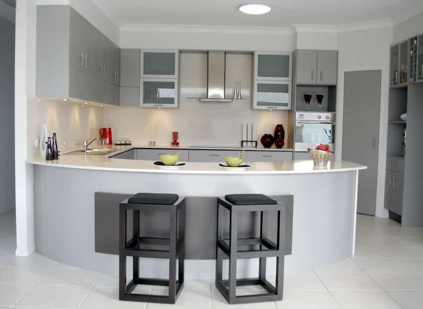 Gray u-shaped kitchen with eat in bar