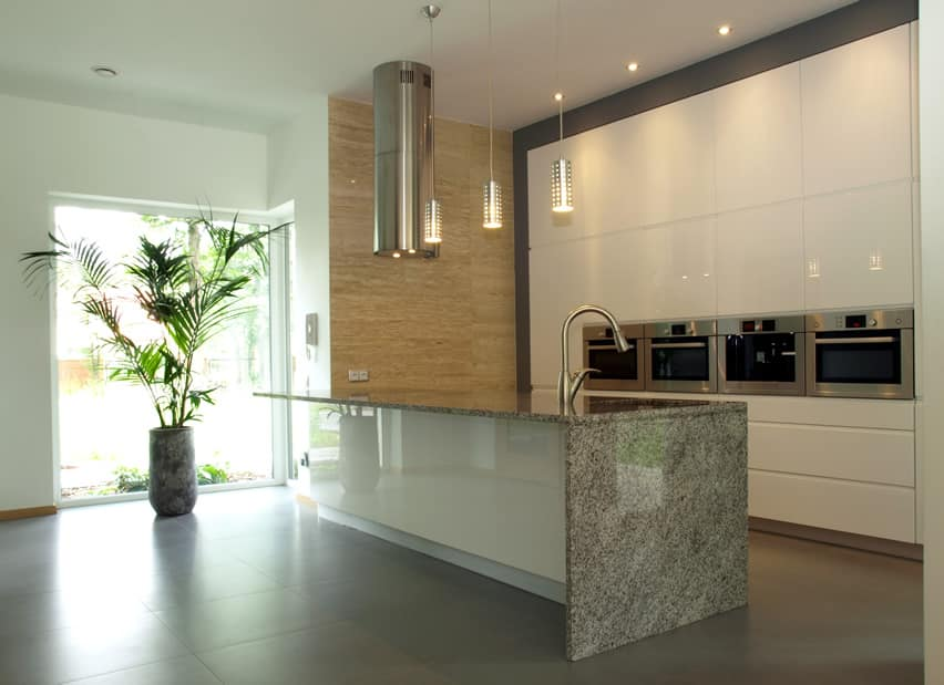 Kitchen with stylish island and modern lighting