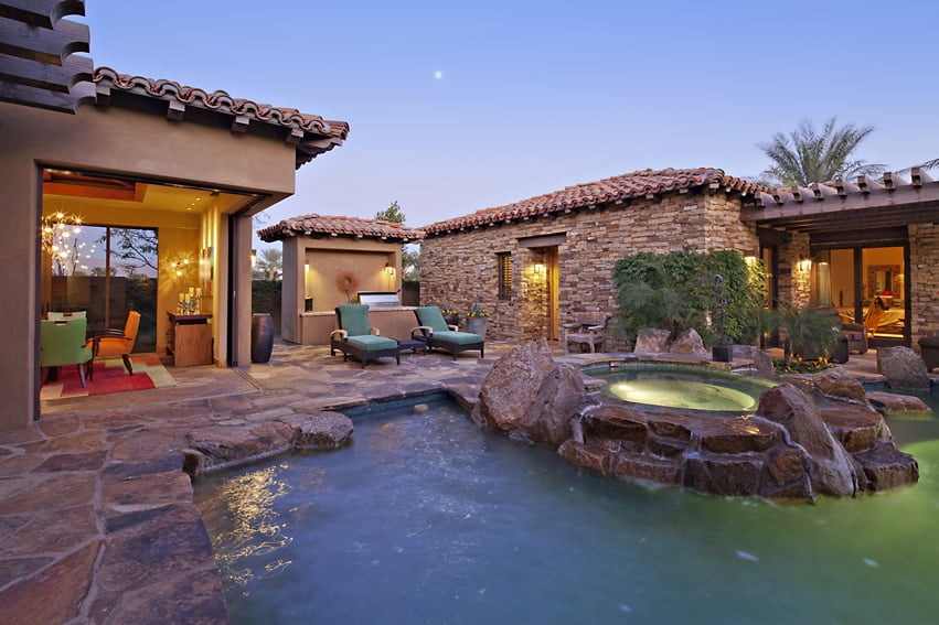 Lagoon swimming pool with hot tub and rock water feature