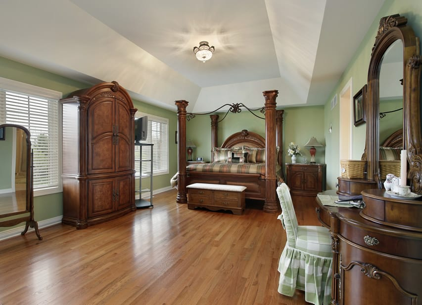 Large bedroom with beautiful wood furniture pillar bed