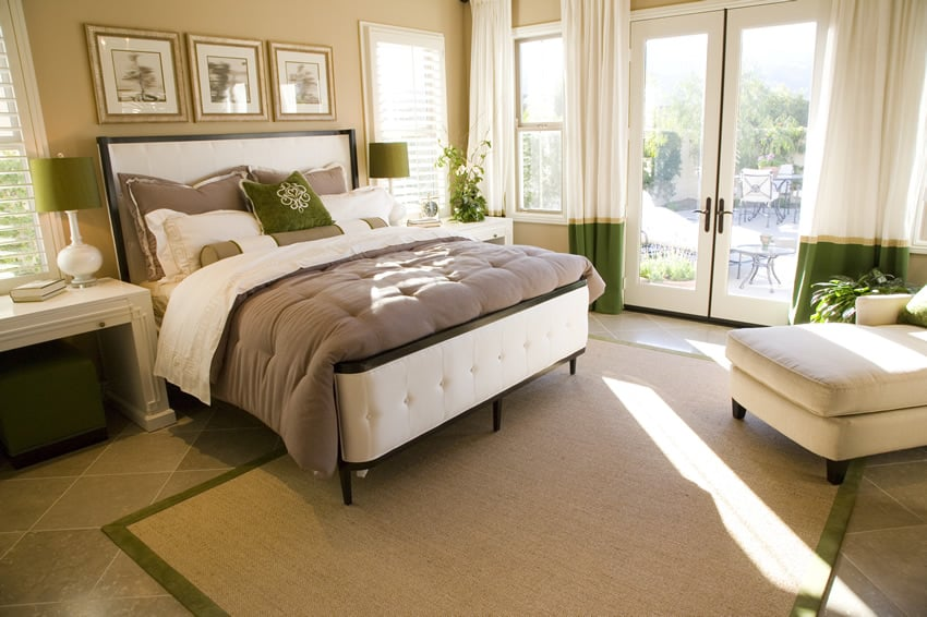 Light and airy bedroom with white upholstered headboard and bed frame
