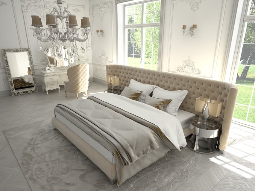 Light glamour bedroom with large custom upholstered headboard