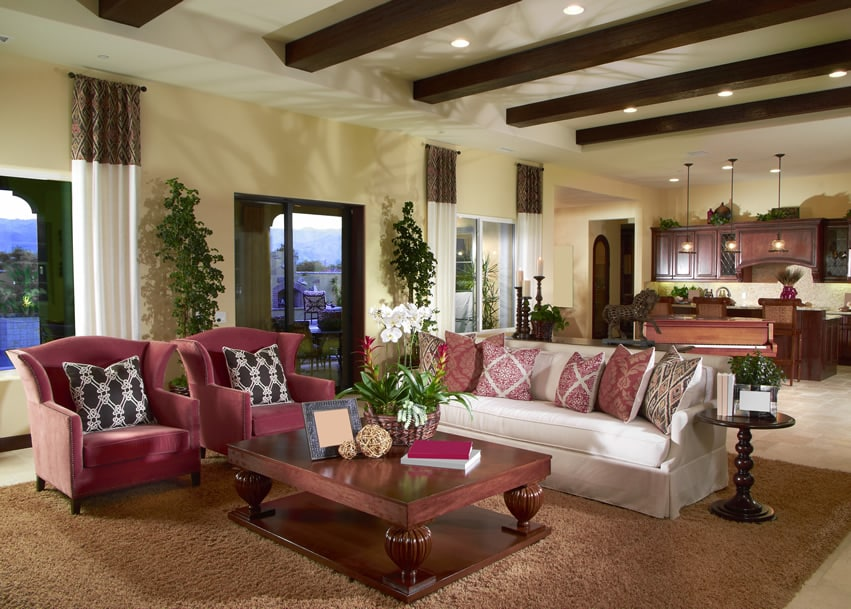 Living room with exposed wood beams and large coffee table