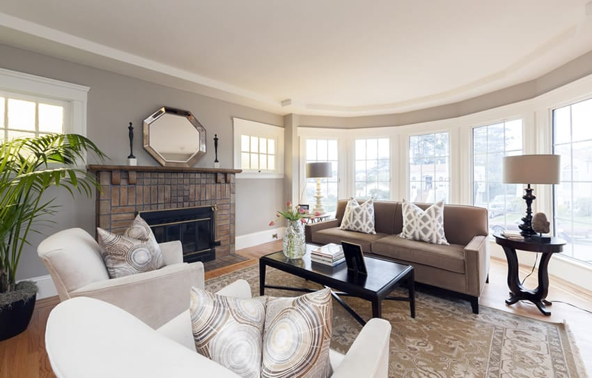 Living room with picture windows and brick fireplace
