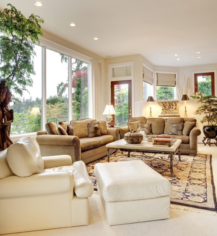 Living room with tan couches white leather chair