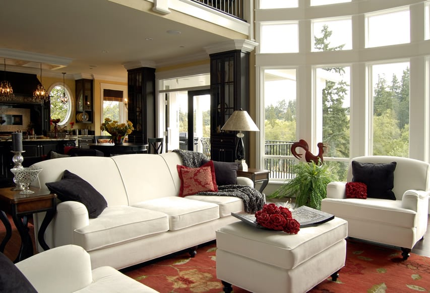 Living room with white furniture and large floor to ceiling windows