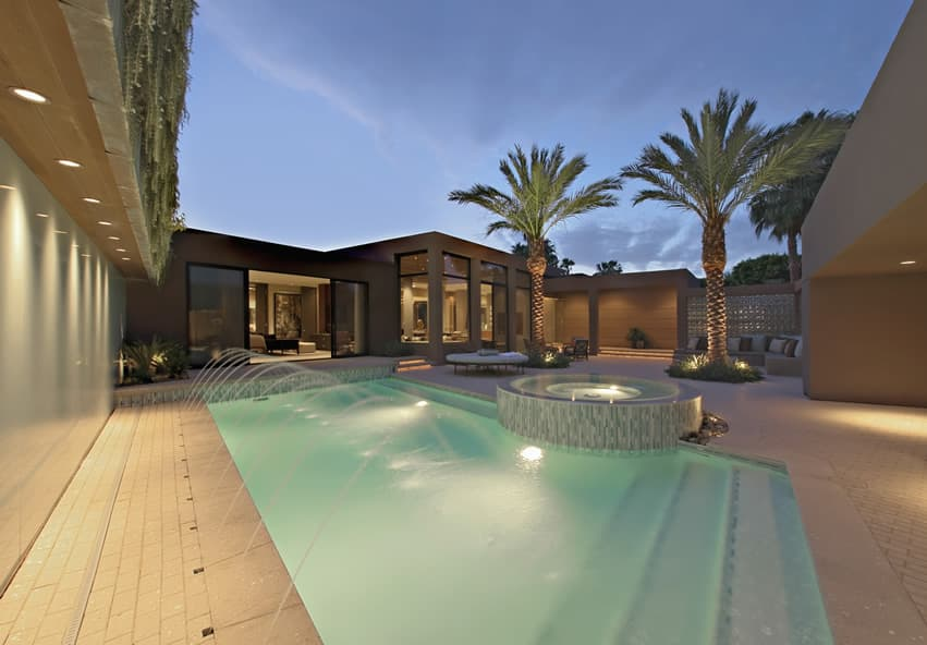 Luxury pool with water feature fountains and hot tub