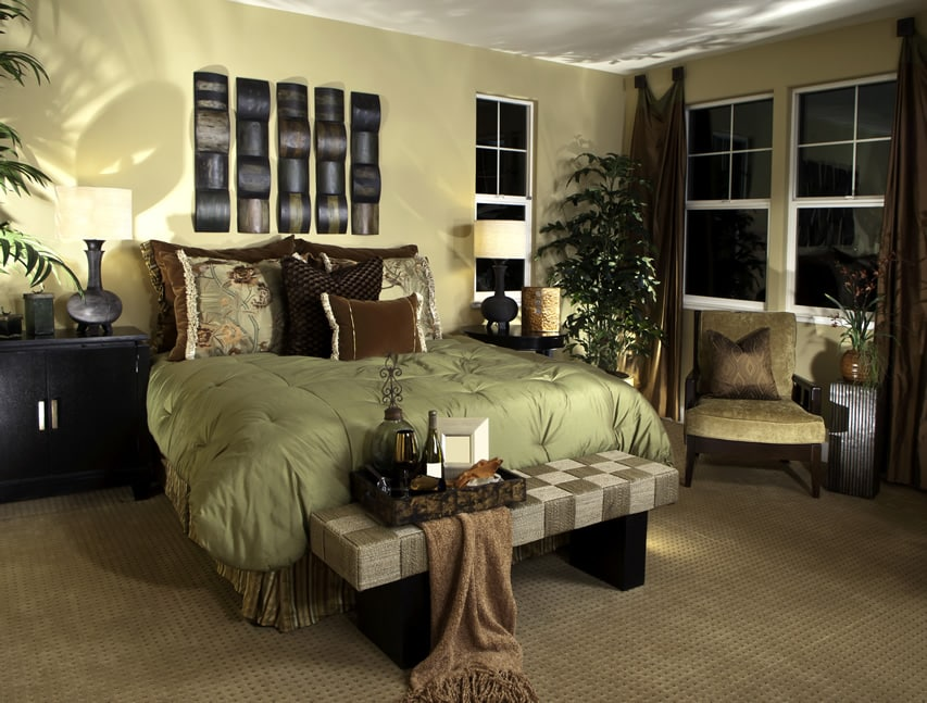 Master bedroom with brown color accents and wood wall art