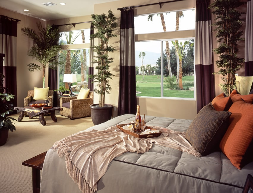 Master bedroom with tropical theme wicker chairs