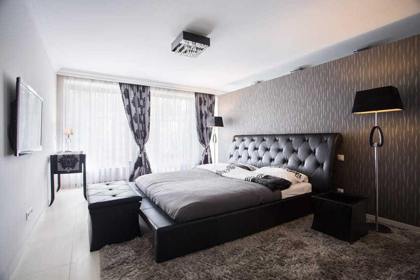 Modern apartment bedroom with leather upholstered bed frame